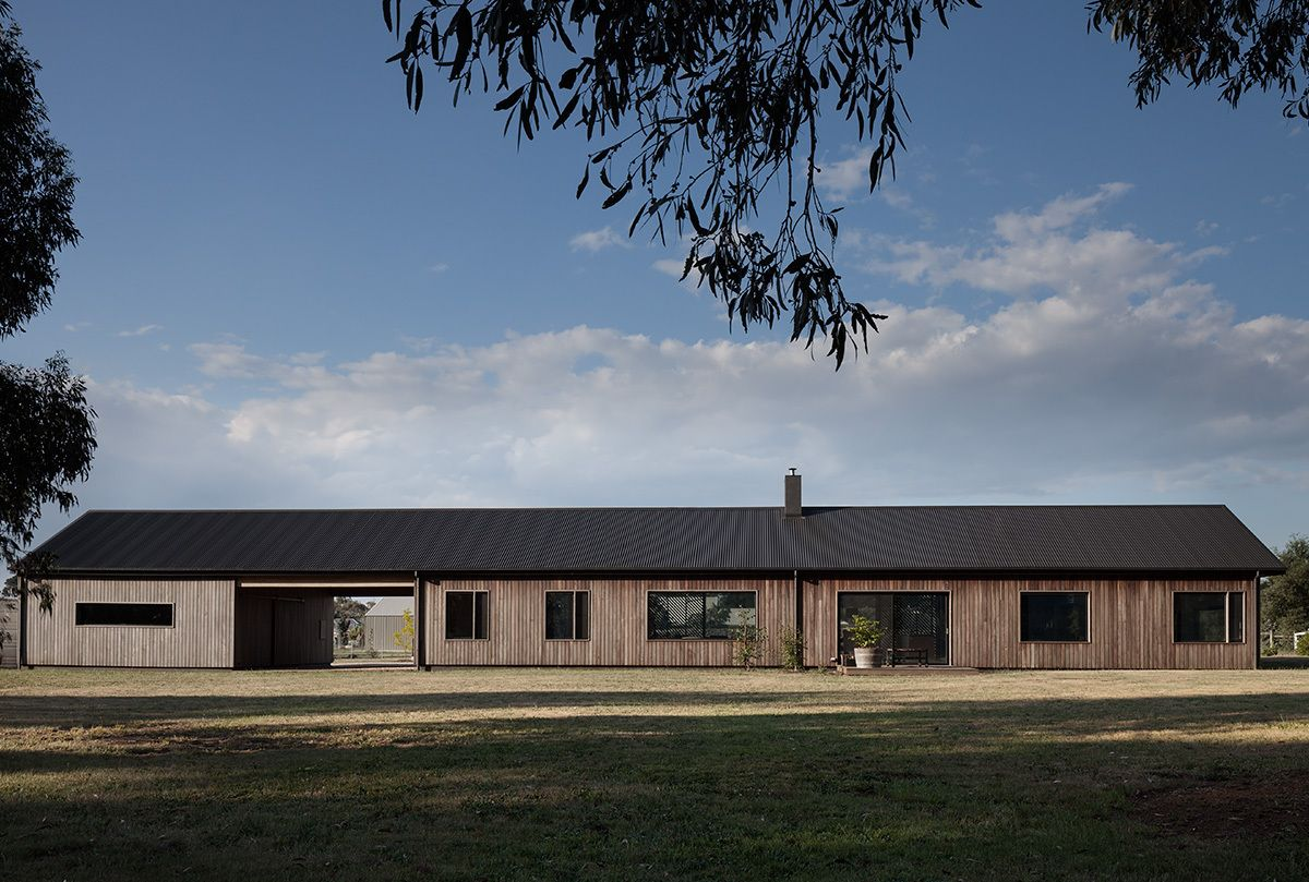 The house is a collection of different volumes all gathered under one gable roof