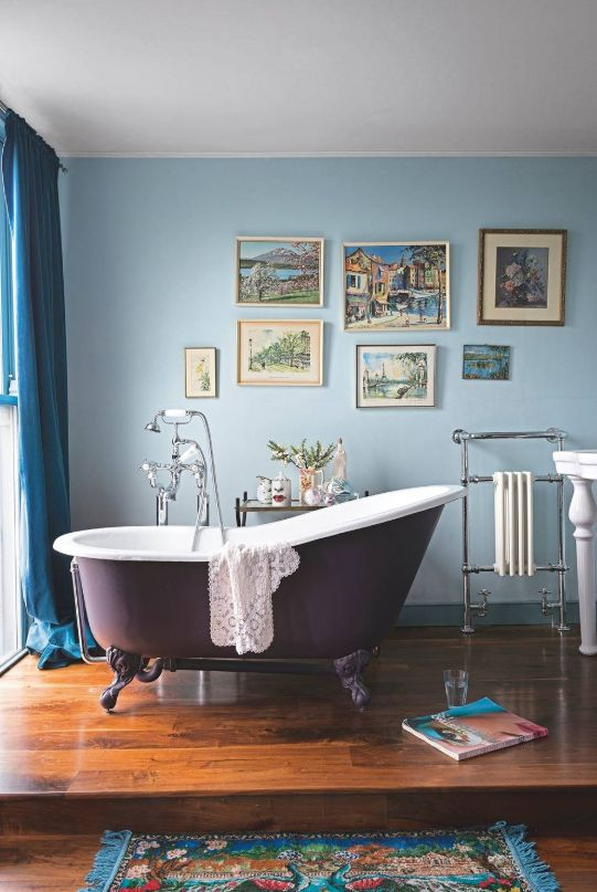 Gallery walls are a great way to bring art into the bathroom.