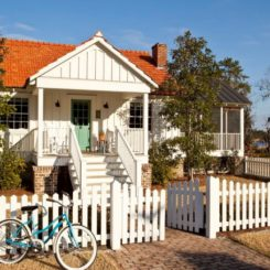 Cottage renovation house with white picket fence and bold front door