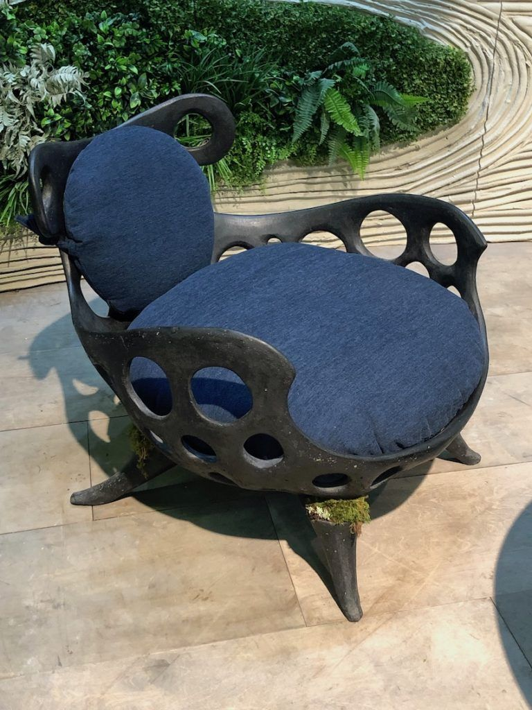A whimsical chair shape includes pockets for planting some greenery.