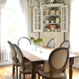 Farmhouse dining room decor with corner cabinet