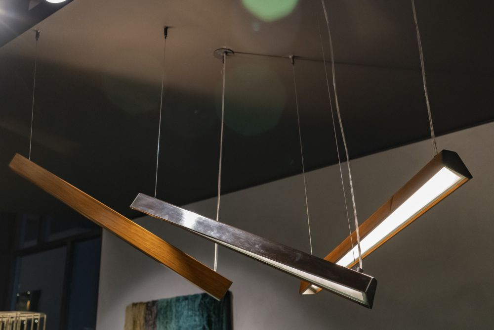 Modern, adjustable lights are more functional than plain pendants.