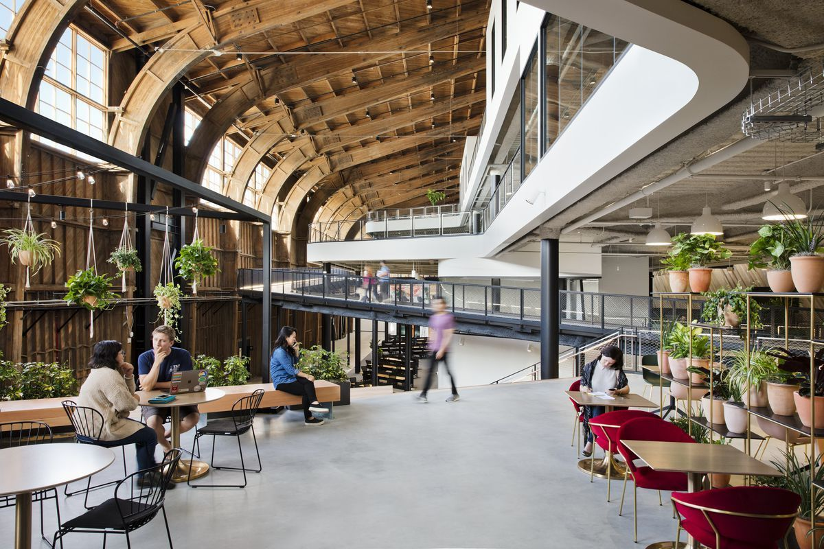 The office is a building within a building, using the historic wooden hangar as a shell