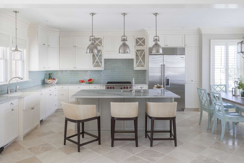 Bar stools that can fit under the island keep the area looking big and open
