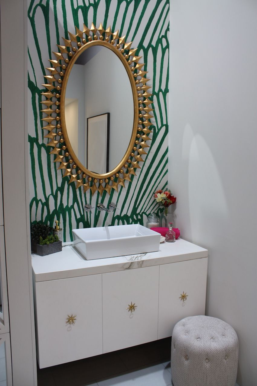 Large scale prints work well in a small space like a powder room.