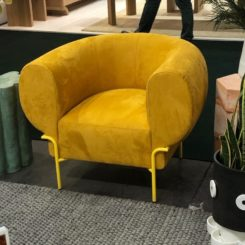 Overstuffed and sunny yellow, this chair makes everyone smile.