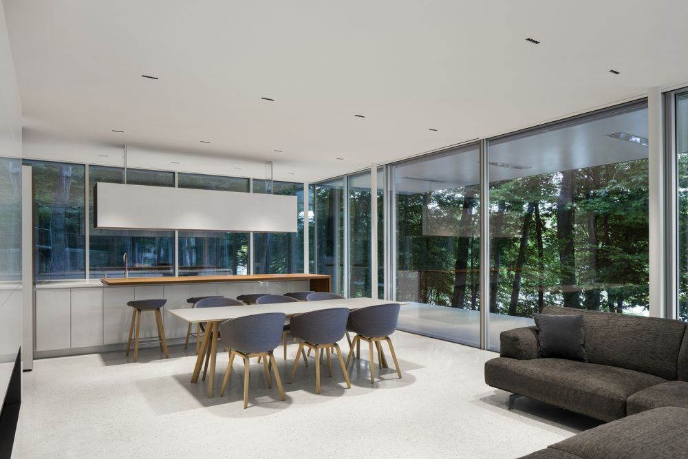The polished concrete floor transitions outside seamlessly, ensuring a fluid and continuous layout