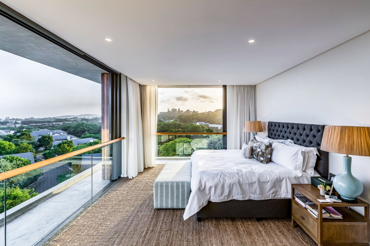 The top floor bedrooms enjoy some of the most wonderful views, looking towards the sea over the tree tops