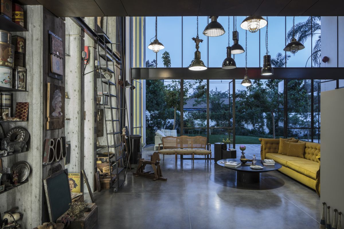 the polished concrete floors, unfinished walls and lighting fixtures give this space a strong industrial vibe
