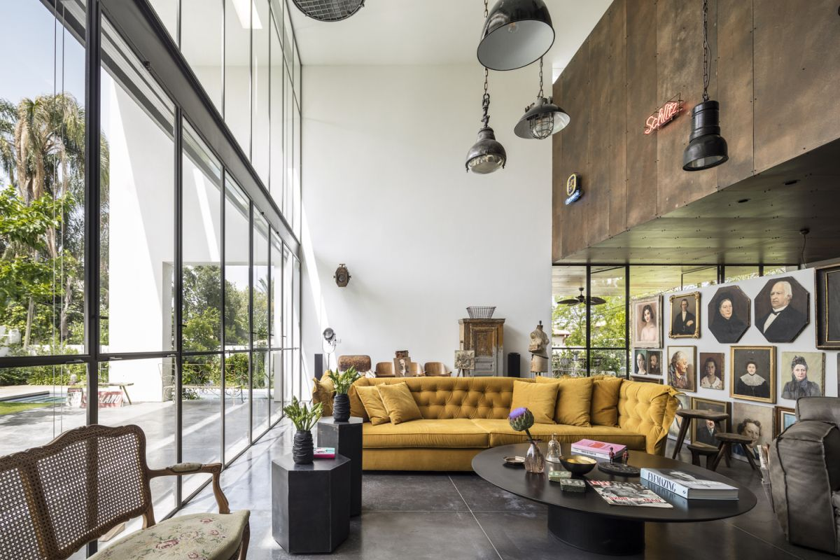 The living room is a double-height volume with two rows of windows that let in lots of natural sunlight