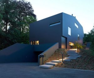 Modern villa with a black facade