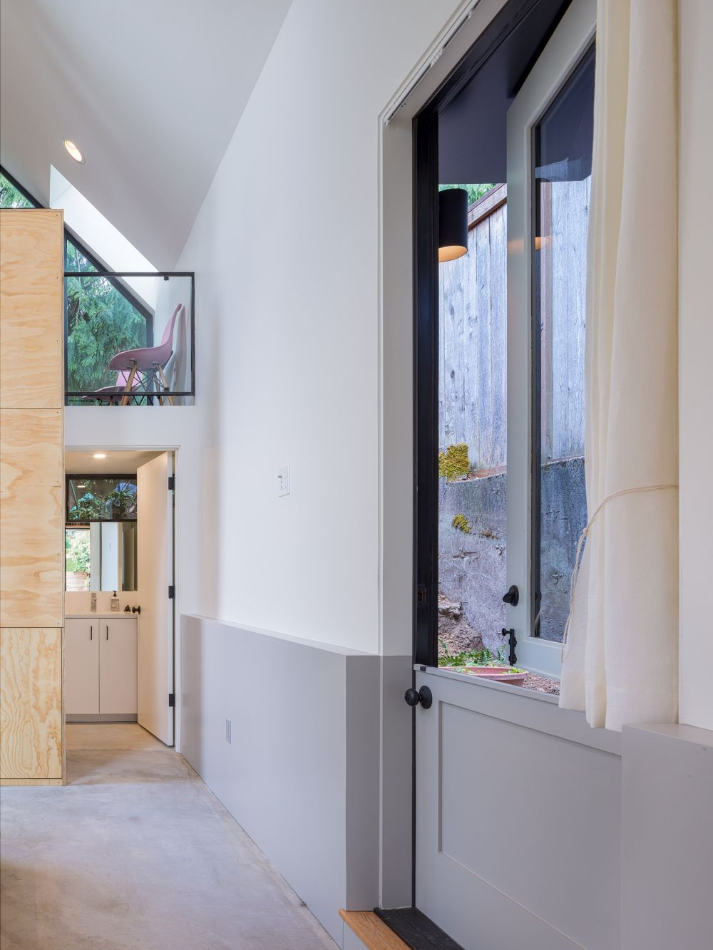 the bathroom is small and is also the only fully enclosed space inside the original structure and the new addition