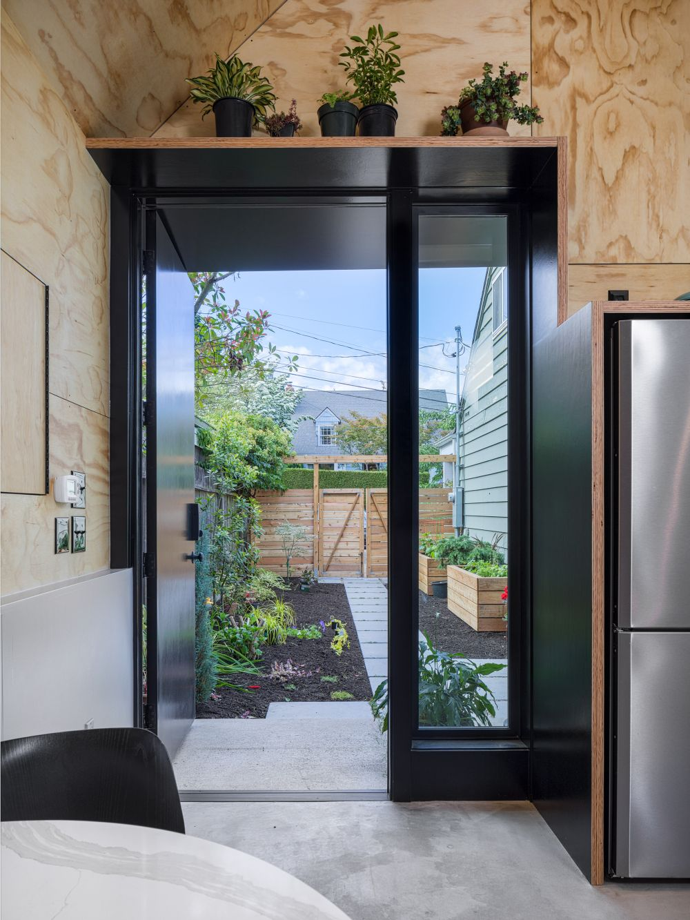 the front door offers easy access into the garden and the glass panel lets in additional sunlight