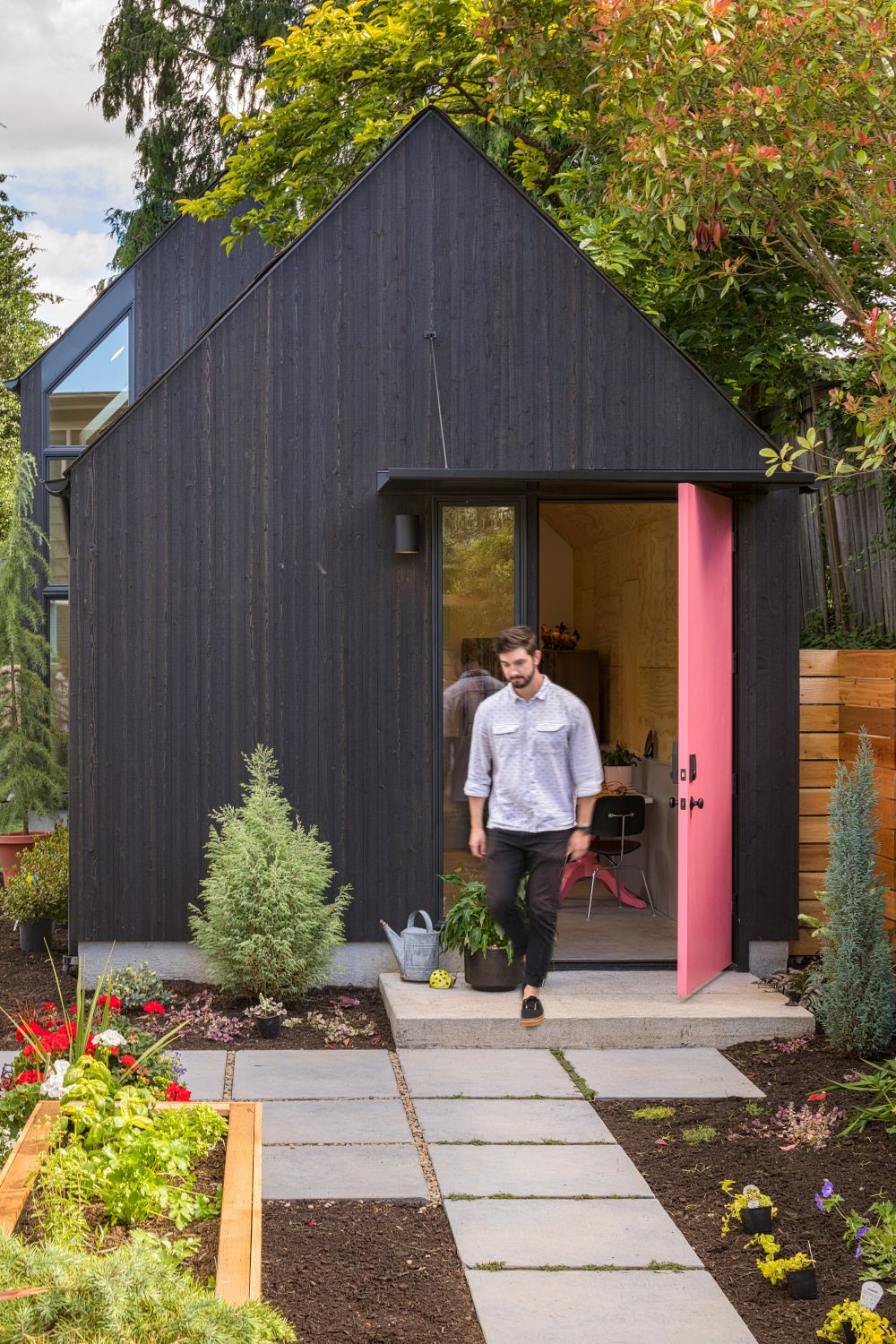 The front door is bring pink and add a quirky touch of color to the design