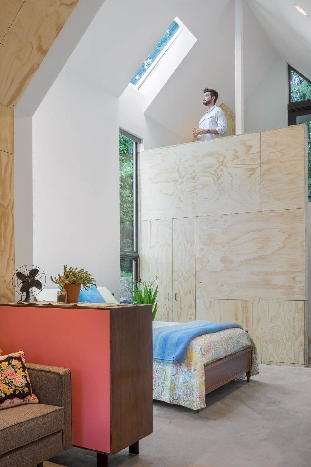 The sleeping area is not a separate space but is placed at the back of the house which gives it sufficient privacy