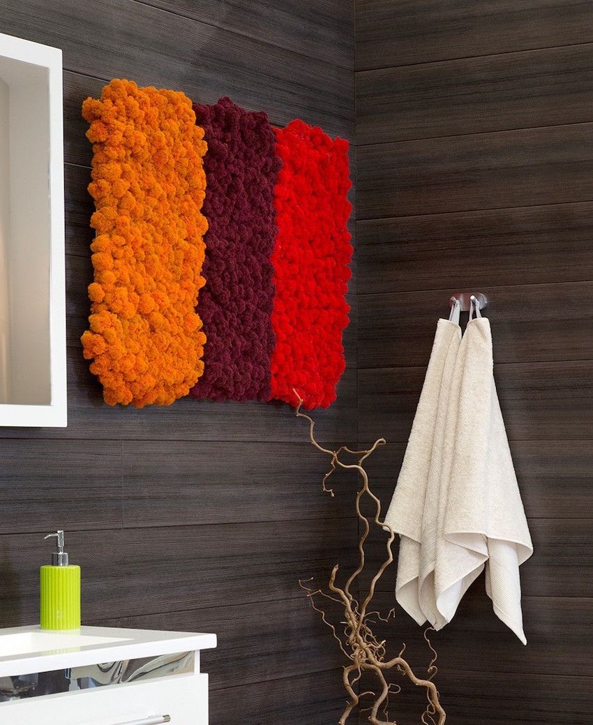 Bathrooms are full of sleek surfaces and need some texture.