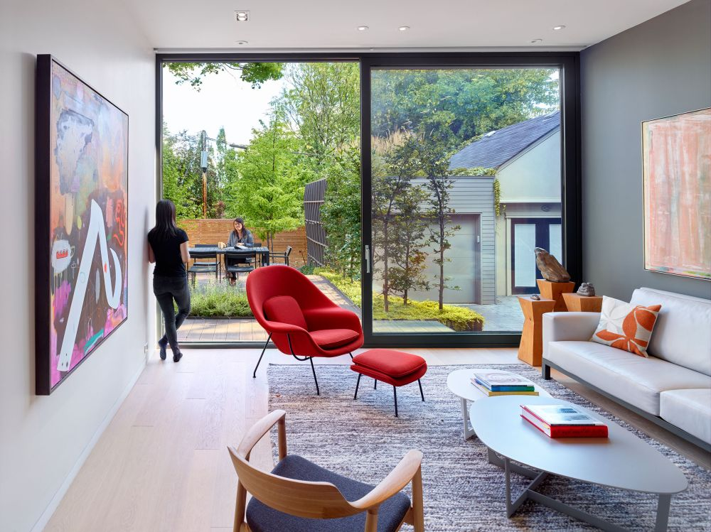 The rear of the house opens up towards the backyard, welcoming the outdoors in