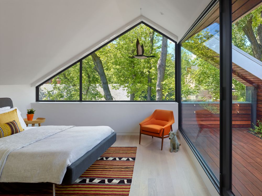 The master bedroom occupies the top floor and has its own open roof deck which bring it closer to nature