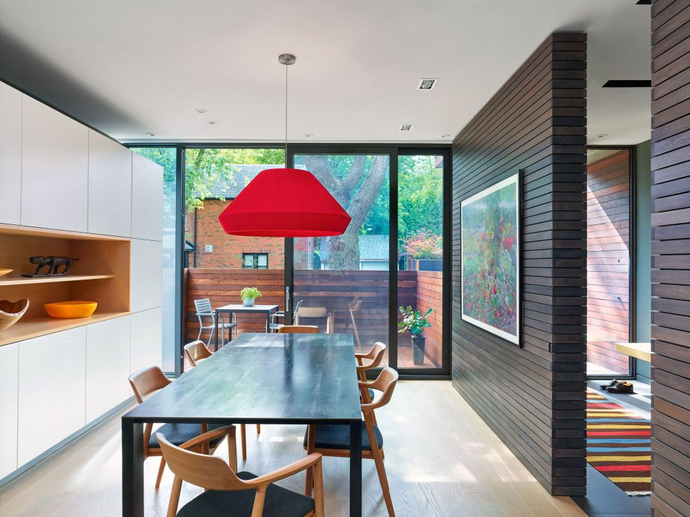 A sliding glass door connects the dining area to the front patio which serves as an extension for the indoor spaces