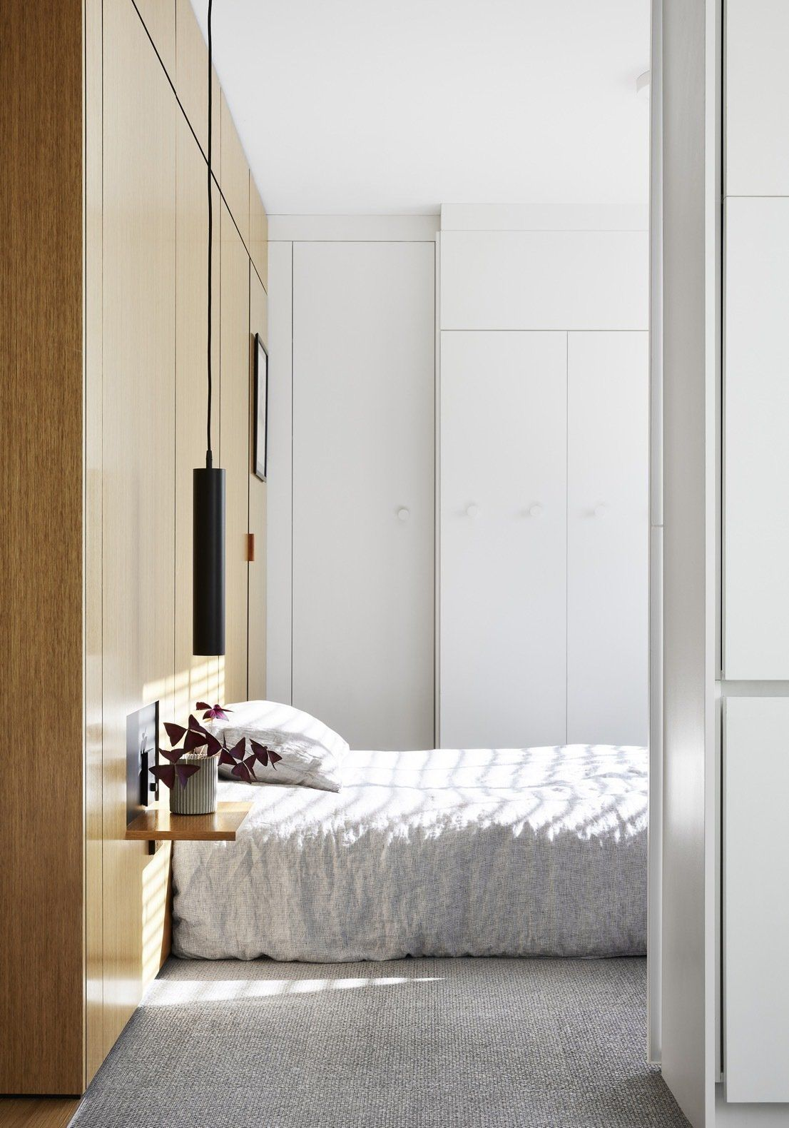 The sleeping area is small but doesn't look or feel tiny thanks to its airy interior design