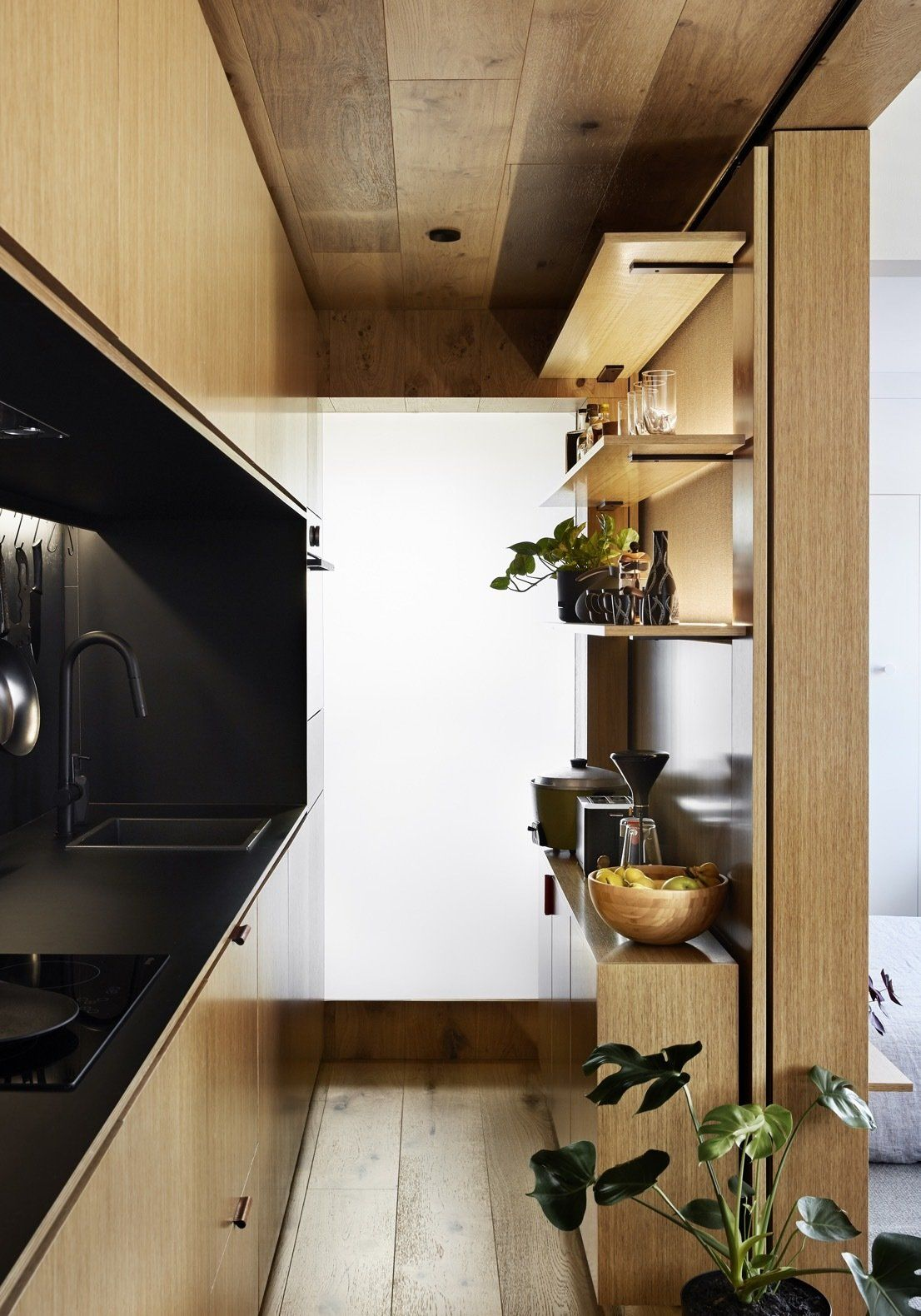 The originally tiny kitchen was expended and turned into a storage-efficient, open and very welcoming space