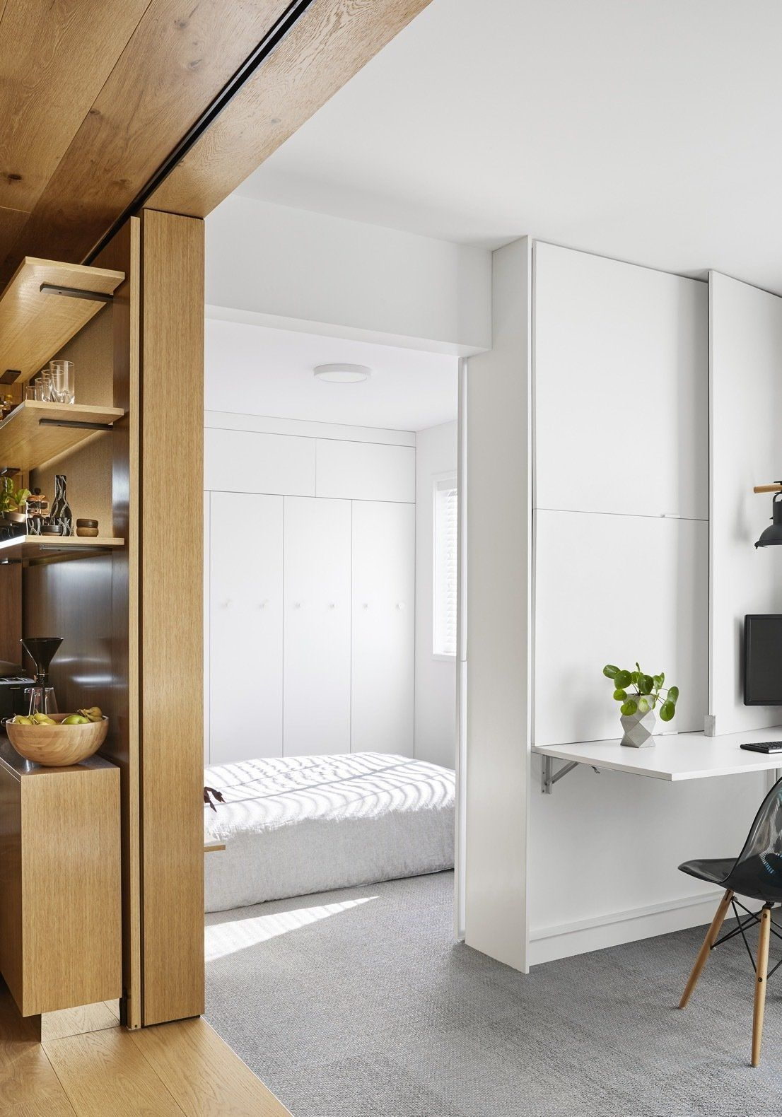 The bedroom is a separate area but still looks connected to the social area