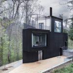 Small house by Hajnoczky.Zanchetta Architekten + Angela Waibel with black facade