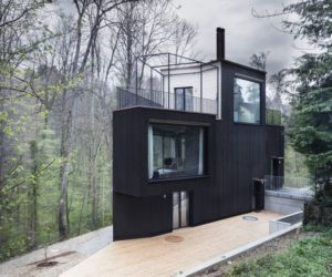 Small house by Hajnoczky.Zanchetta Architekten + Angela Waibel with black facade