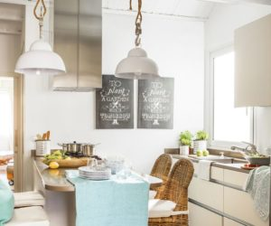 Small kitchen with rattan breakfast nook area