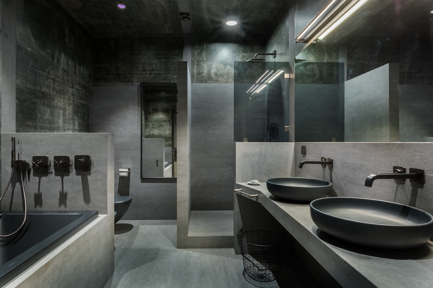Gray is also the main color featured in the bathrooms and the design doesn't lack character