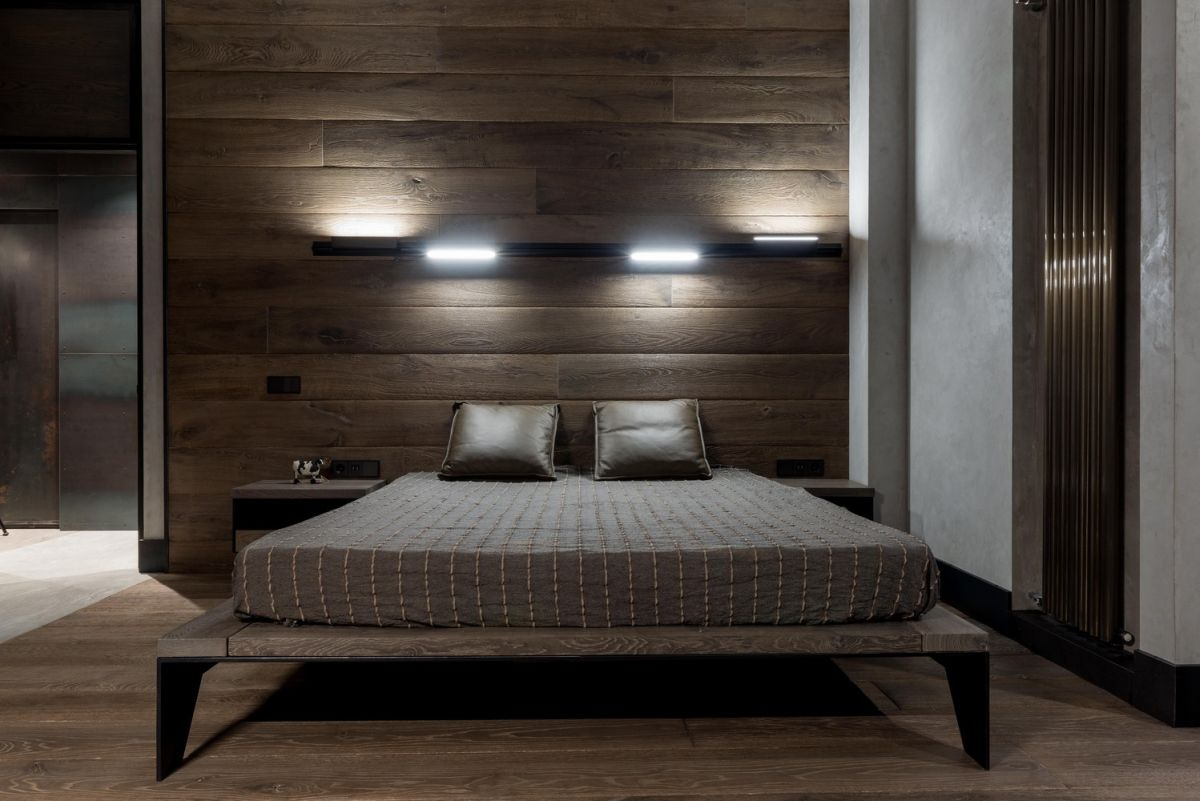 The bedrooms have wood-paneled walls and wooden floors which gives them a warm and cozy look