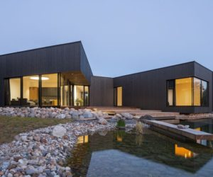 Wood cladding Black House on Nevezis River Slope
