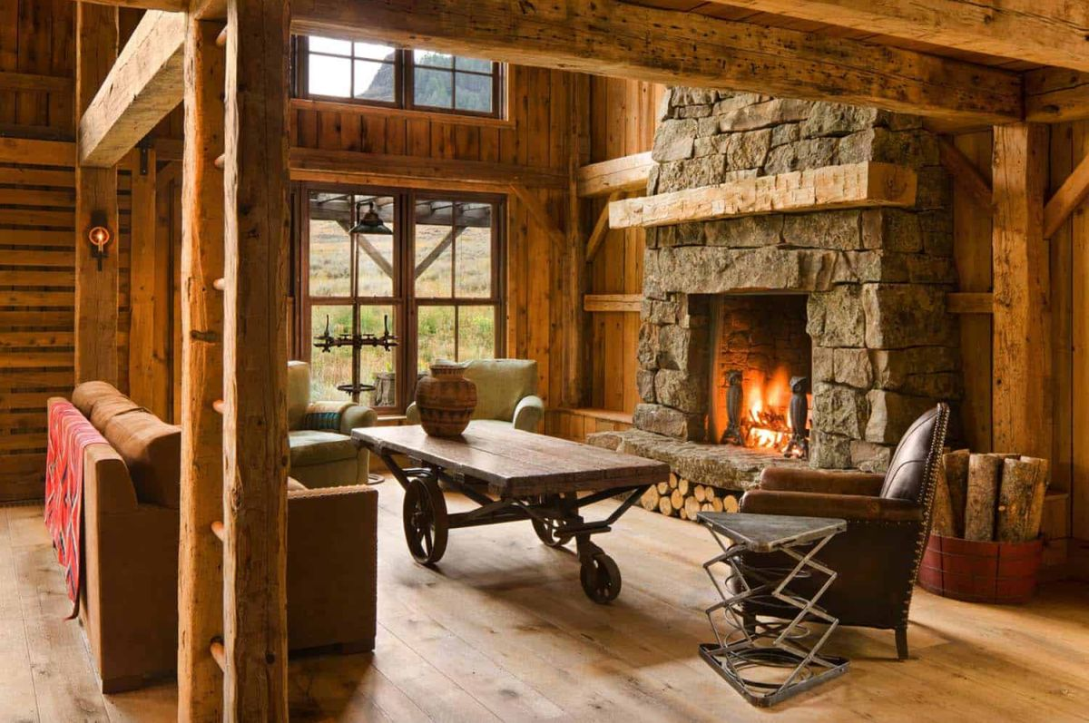 The focal point of the living room is a large stone-clad fireplace which covers almost an entire wall