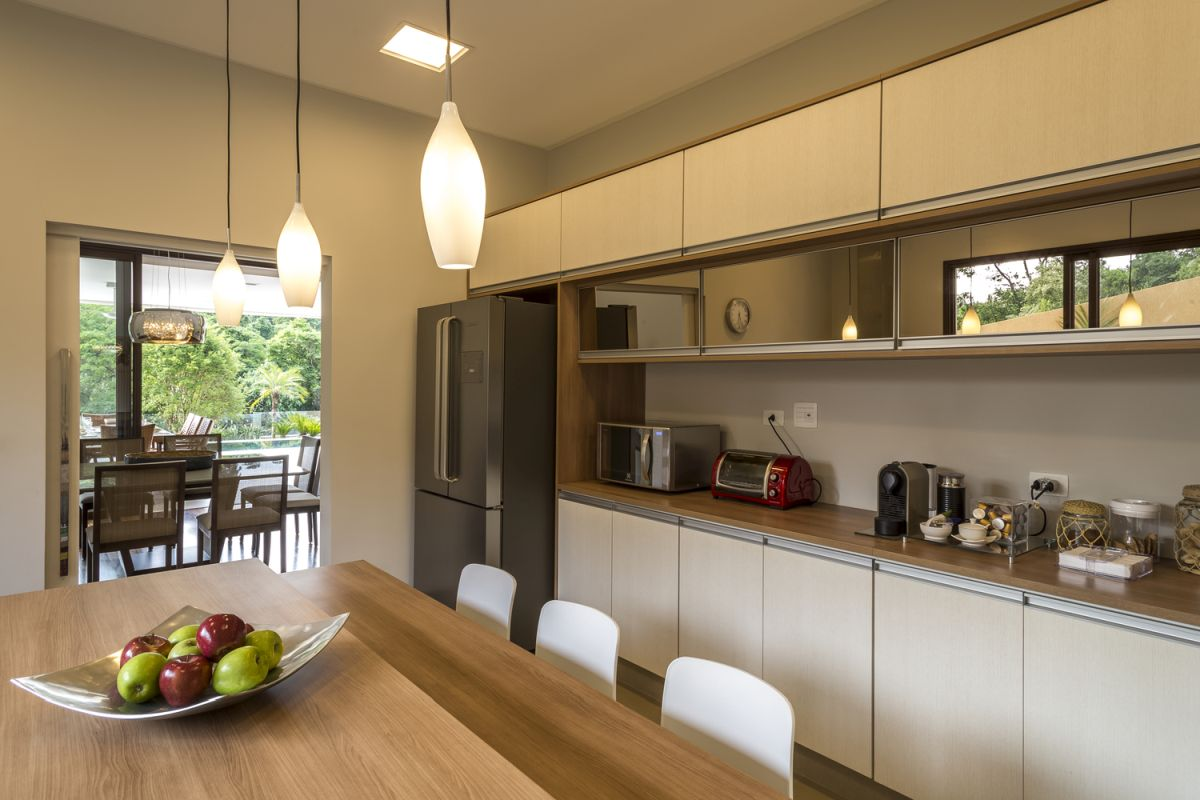 The kitchen and dining room are blended into one space with a very warm and inviting appearance