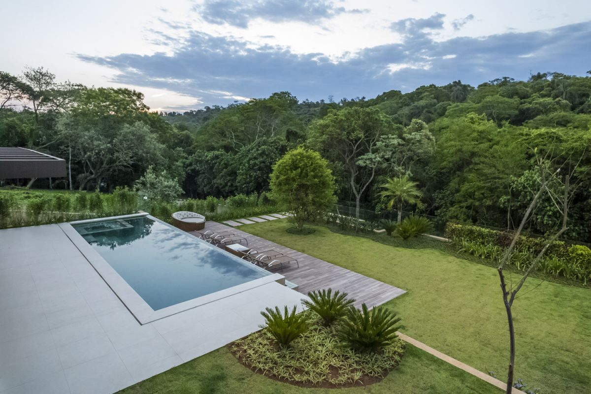 There's a wooden deck one level below the pool, overlooking the garden and preserving an unobstructed view