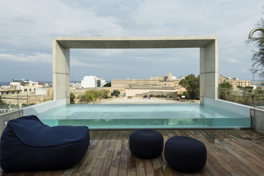 On the rooftop there is a transparent swimming pool complemented by an open deck