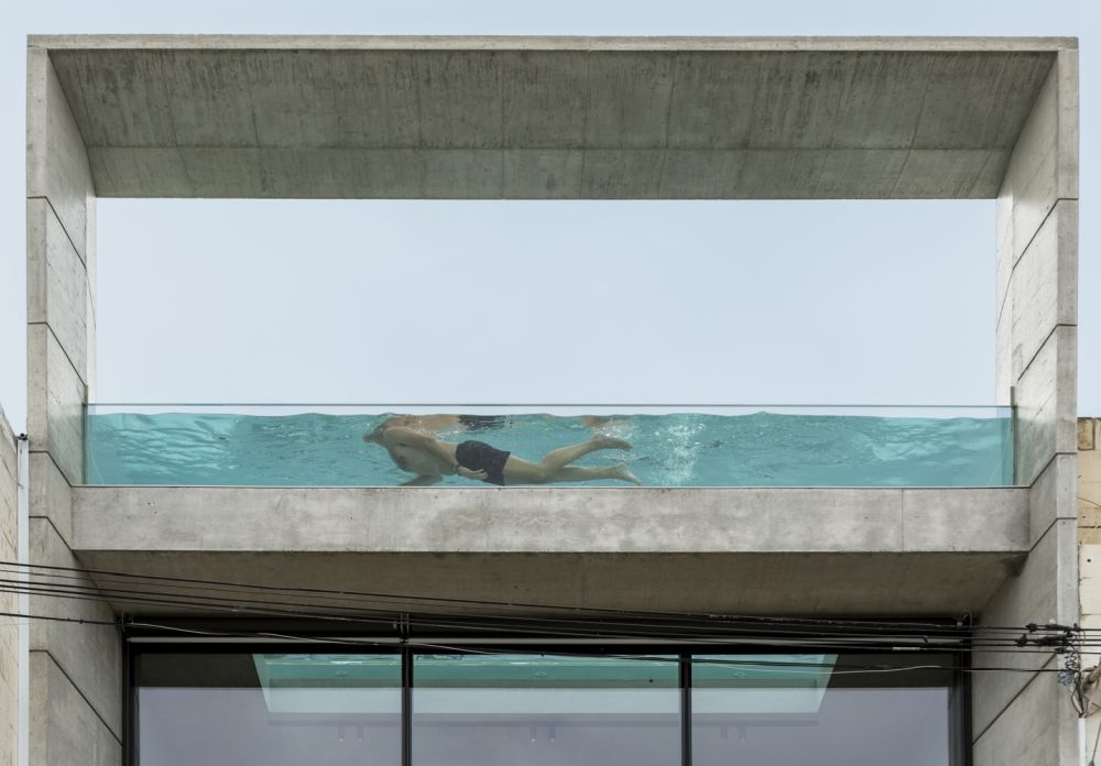 The swimming pool has a glass bottom and glass sides which make it almost completely transparent