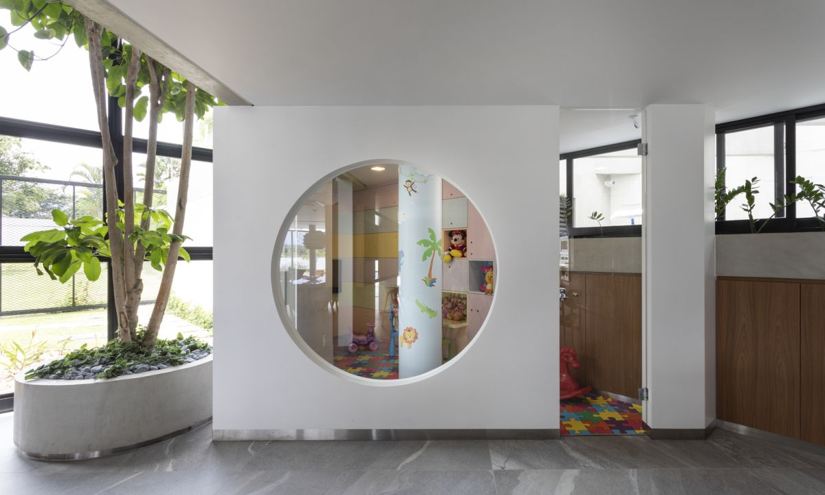 The playroom area resembles a box with a large circular window and looks very playful