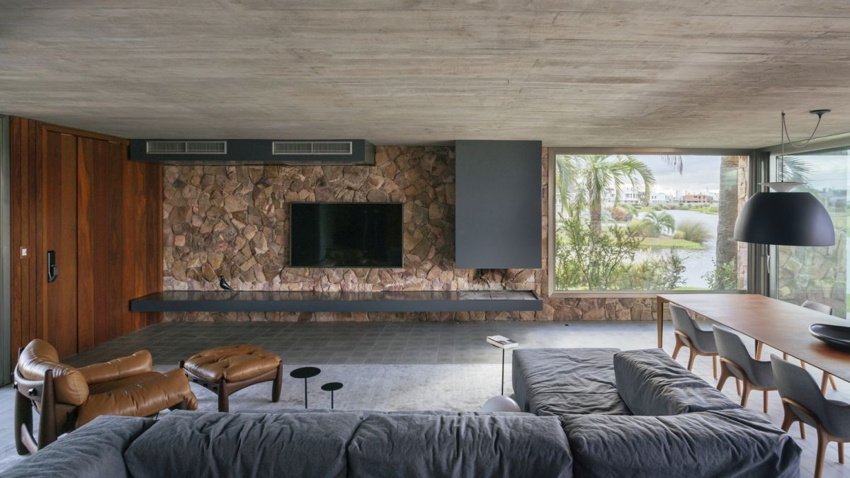The interior design is defined by a palette of natural materials and finishes, including stone and wood