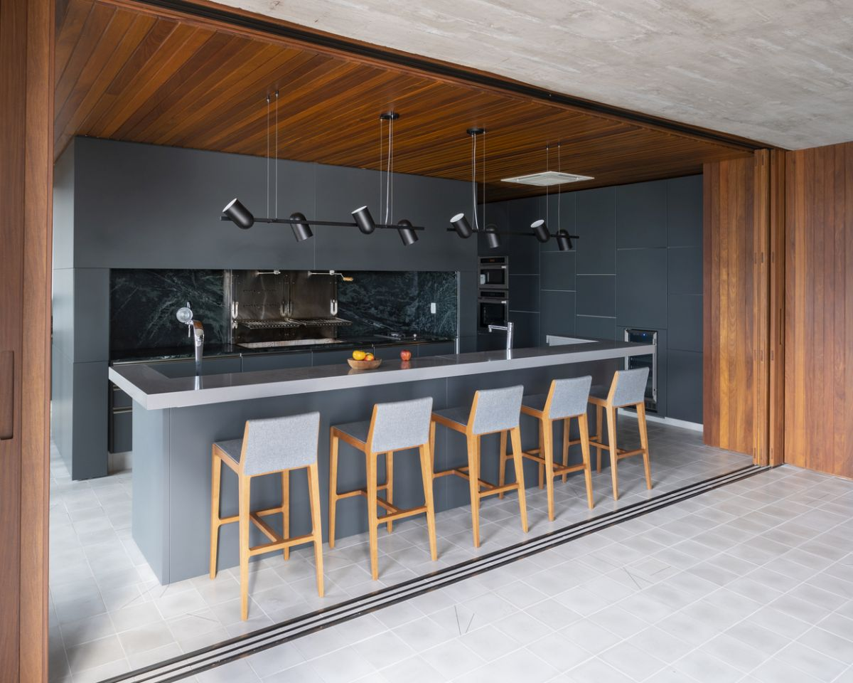 The selection of materials and finishes gives the spaces a slight industrial appearance