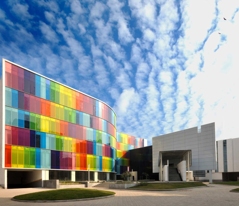 Colorful Buildings: 12 Mesmerizing Buildings With Colored Glass Facades