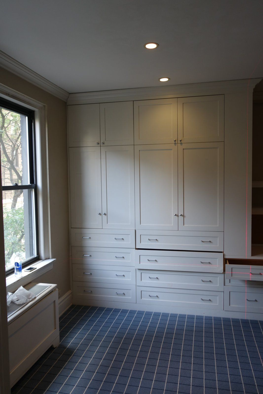 The second bedroom originally featured a large wall unit with lots and lots of storage