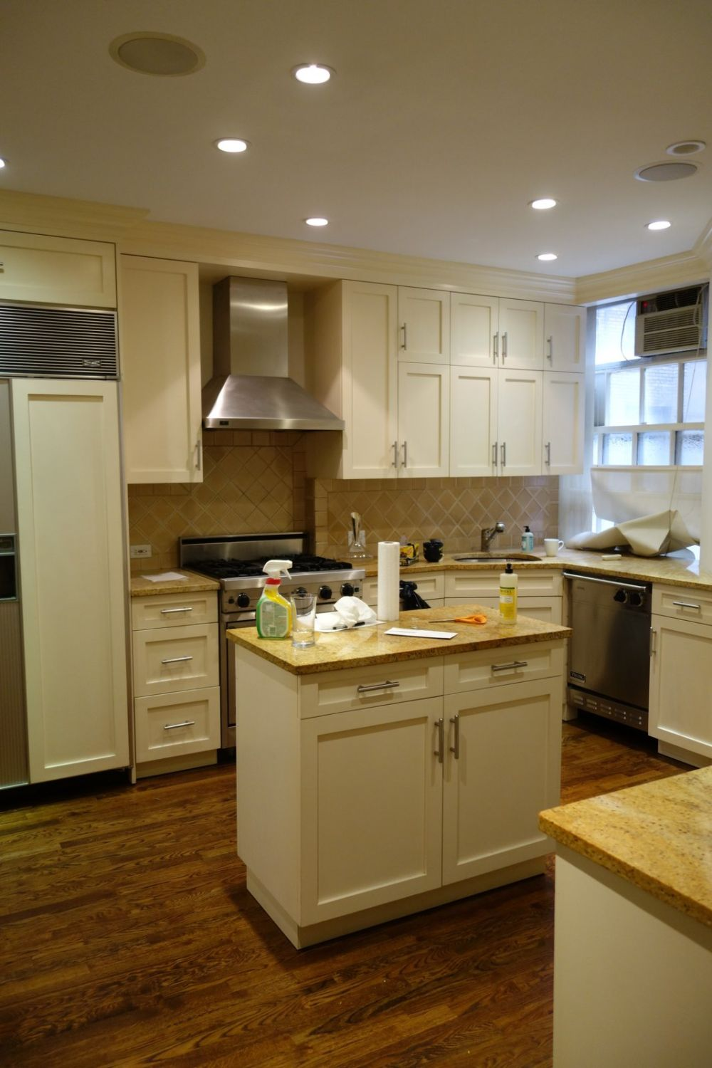 The initial kitchen setup featured lots of furniture which created a rather cluttered appearance