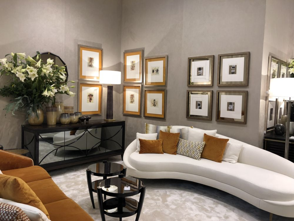 Turn one of the walls of your living room into art galleries by displaying framed artwork