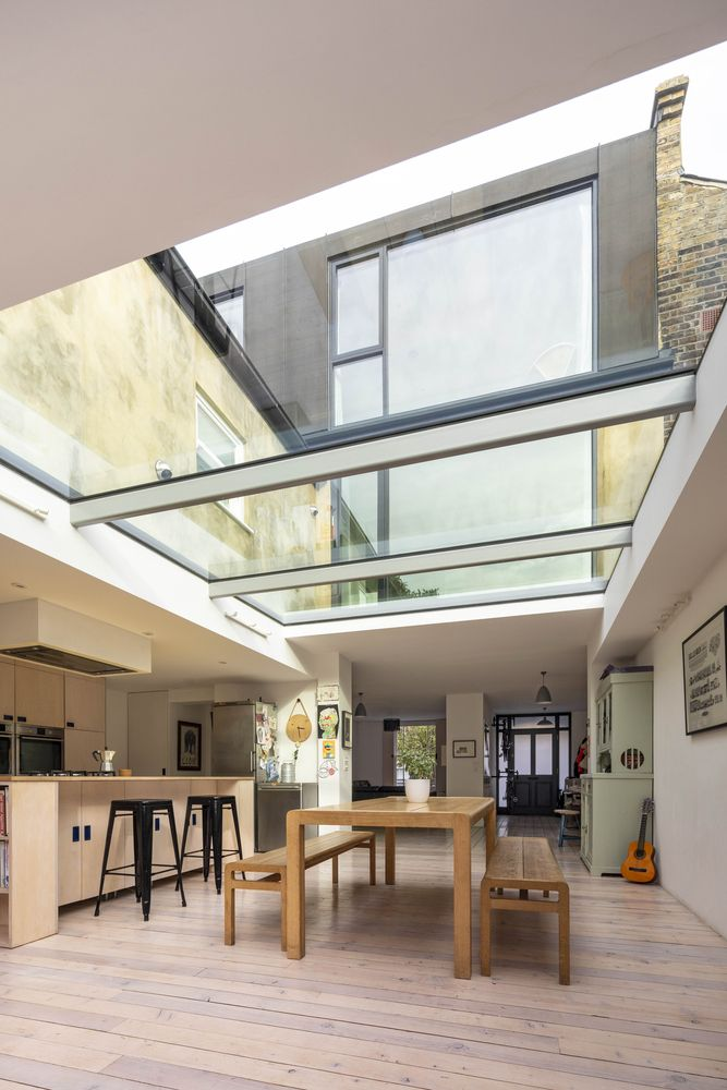 The skylights bring in lots of natural light and create a strong bond between the indoor and outdoor
