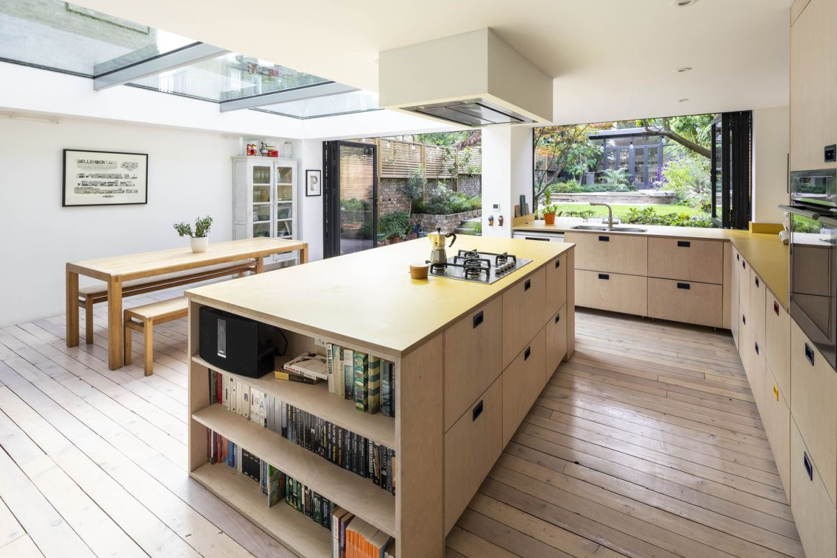 The kitchen island is also a great separator between the cooking area and the dining space