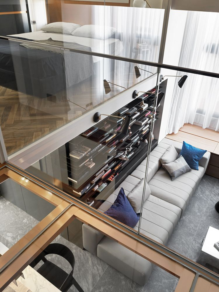 The glass walls and railings create a very strong bond between the two floors