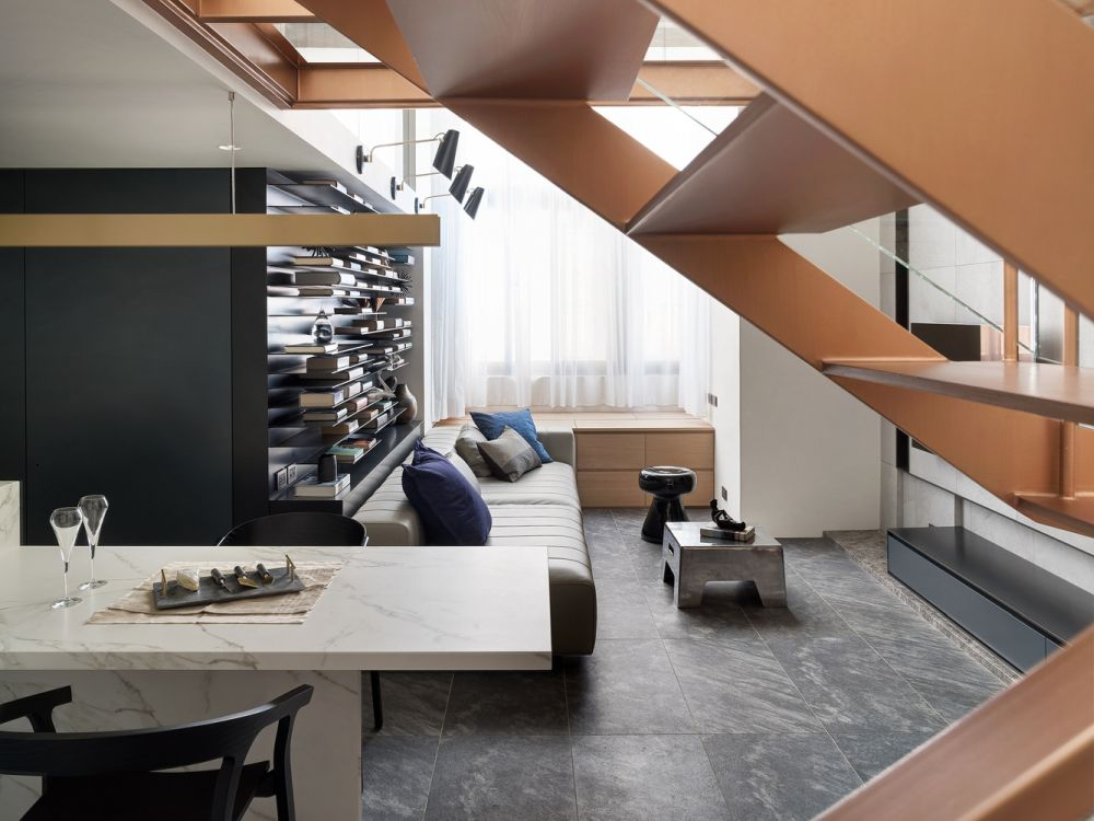 The bookshelves and the wine rack put an emphasis on the horizontal plane