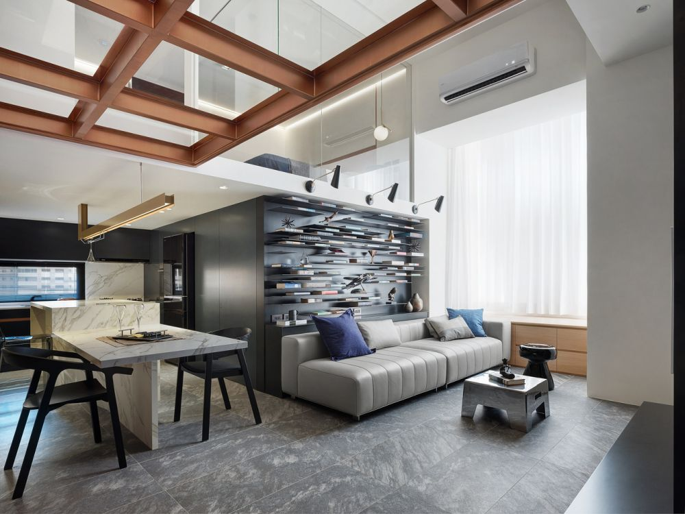 The living area features a double-height ceiling which gives this entire floor a very airy look