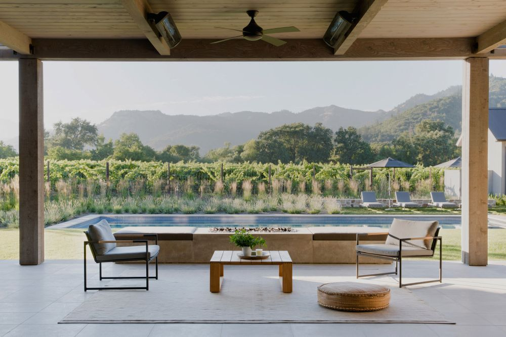 A large covered patio allows the living areas to extend outdoors and offers views of the vineyards and mountains